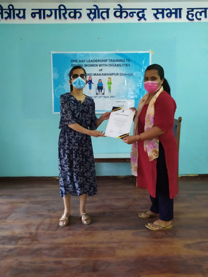 Certificate distribution to the participant, Ms. Saraswoti Katwal who have completed TOT and hence facilitated the session in grassroot level of respective district.