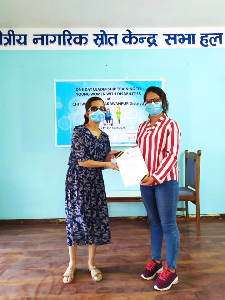 Certificate distribution to the participants, Ms. Pramila Humagain who have completed TOT and hence facilitated the session in grassroot level of respective district.