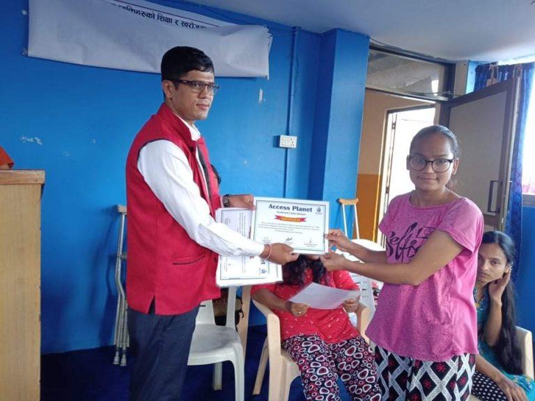 Computer trainee receiving certificate from computer trainer Mr. Arjun Acharya.